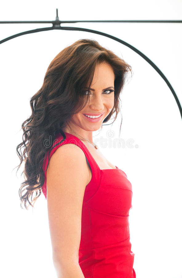 Attractive smiling woman. Attractive smiling woman shooting in photo studio royalty free stock photography