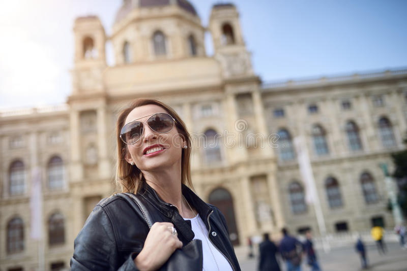 Attractive smiling woman in sunglasses royalty free stock photography