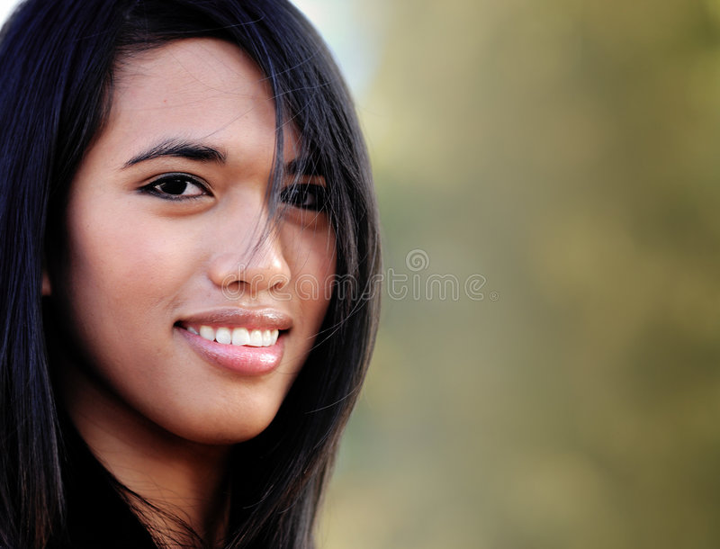 Attractive smiling young Asian woman stock photography
