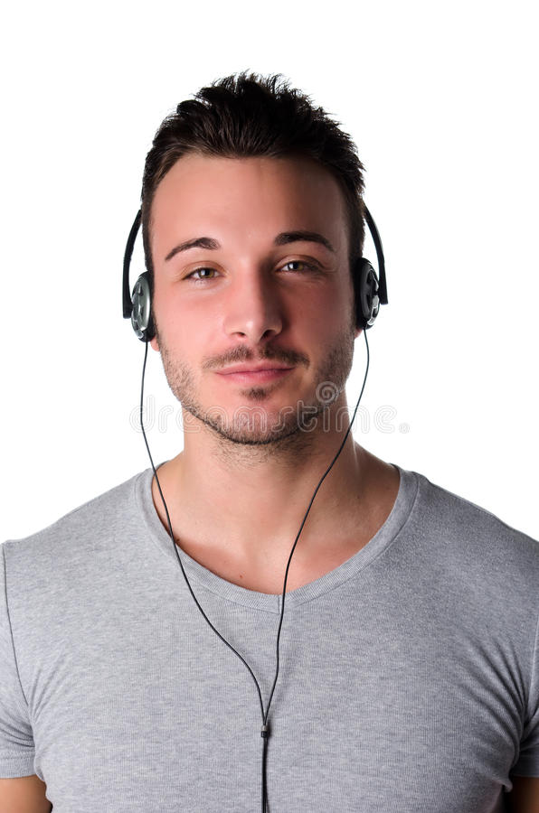 Download Attractive Smiling Young Man Listening To Music With Headphones Stock Photo - Image of headphones, youth: 31780766