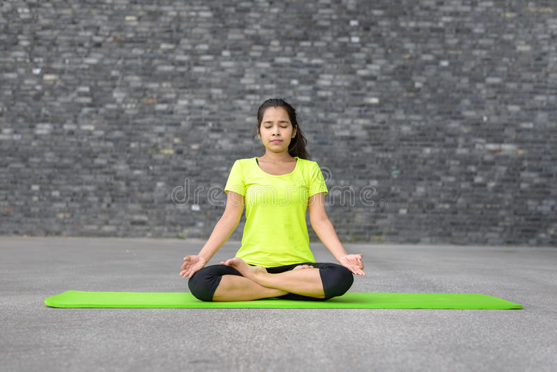 Attractive spiritual young woman doing yoga royalty free stock photos