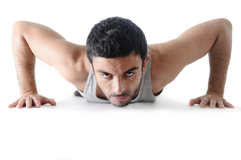 Attractive sport man training push up exercise isolated on white stock photography