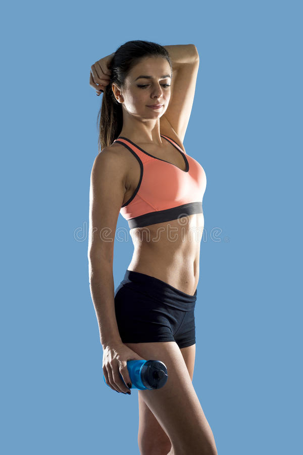Attractive sport woman in fitness clothes smiling happy in aerobics training workout posing. Young attractive sport woman in fitness clothes smiling happy in stock image