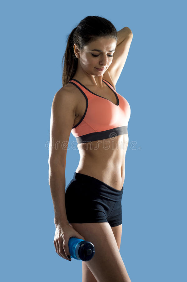 Attractive sport woman in fitness clothes smiling happy in aerobics training workout posing. Young attractive sport woman in fitness clothes and smiling happy in stock image