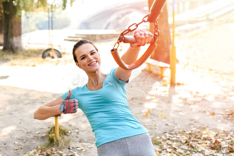 Attractive sportswoman training, smiling with thumb up outdoors stock photography