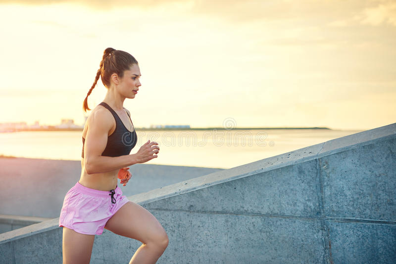 Attractive sporty young woman out jogging stock image