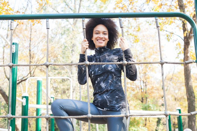Attractive Sporty Young Woman At Outdoor Fitness Park stock photo