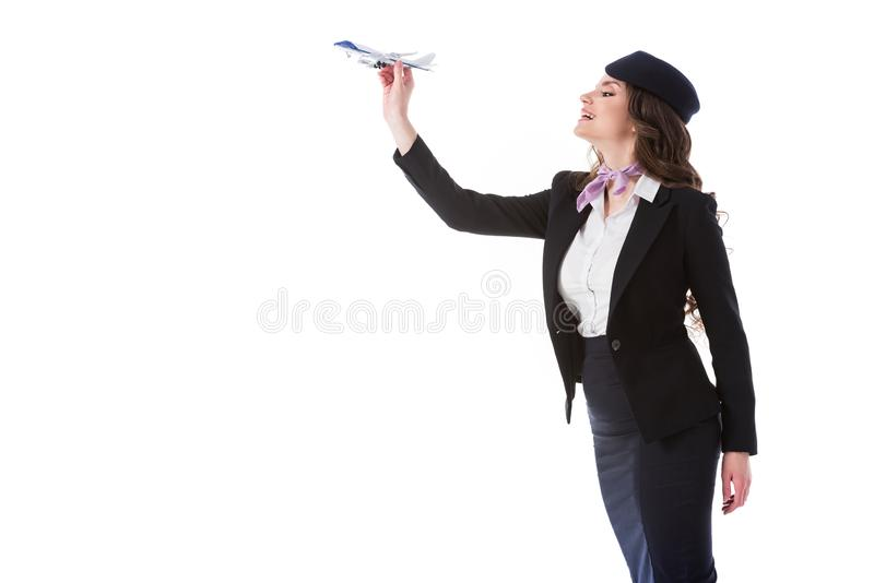 attractive stewardess throwing plane toy stock images