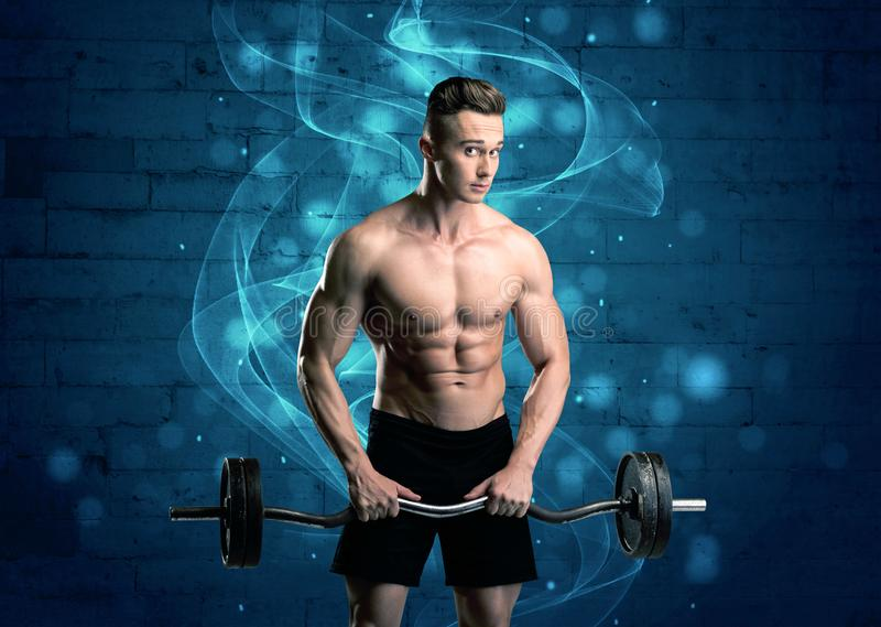 Attractive strong fitness guy lifting weight stock image