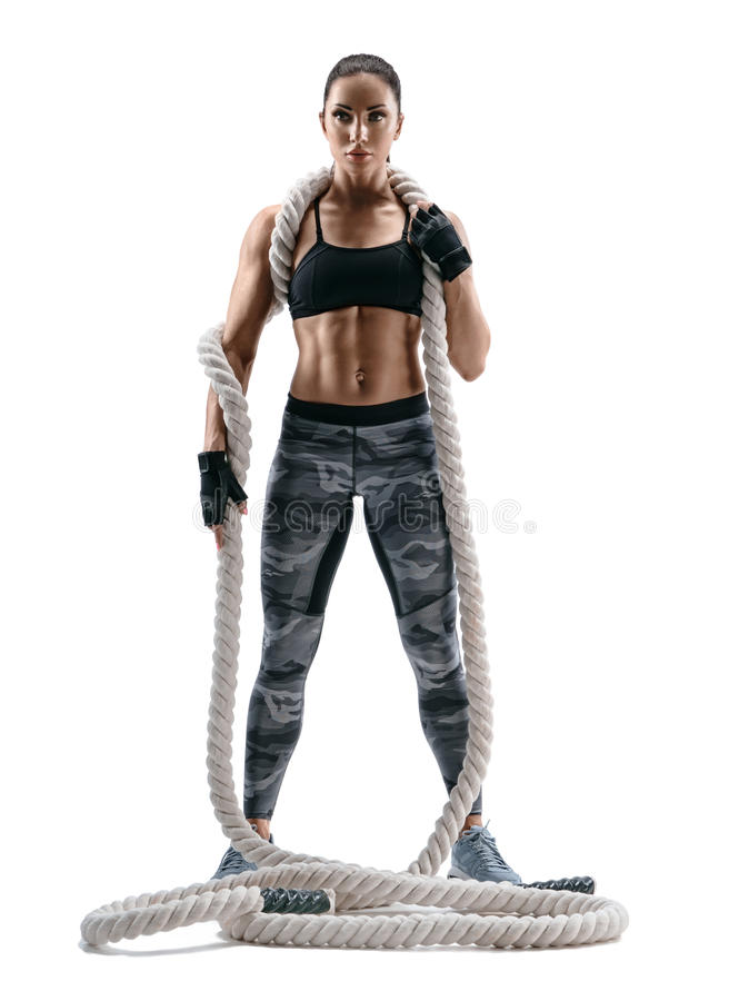 Attractive strong woman with heavy ropes on her shoulders. royalty free stock photos