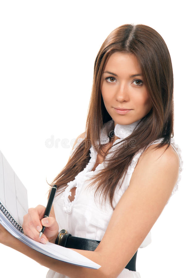 Attractive Student Holds Notepad And Pen In Hand Stock Image