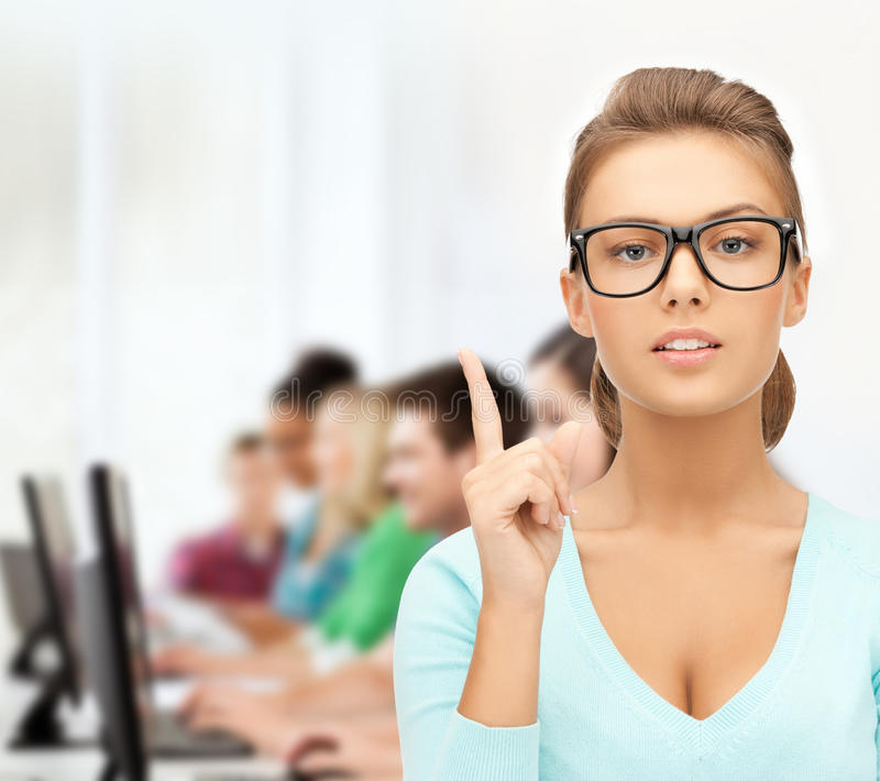 Attractive student wearing glasses in college. Education, vision, optics concept - attractive student or teacher wearing glasses in college royalty free stock images