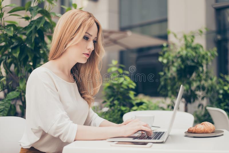 Attractive stylish manager having brunch in caffe terrace, tired royalty free stock photos