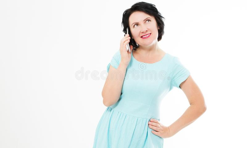 Attractive, successful and happy middle aged brunette woman in blue dress female using mobile cell phone royalty free stock photo