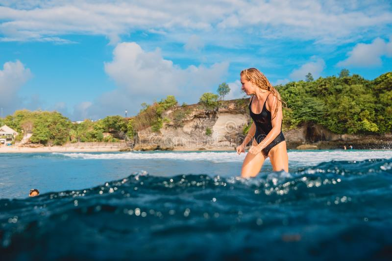 Attractive surf girl on surfboard. Woman in ocean during surfing. Surfer and ocean stock images