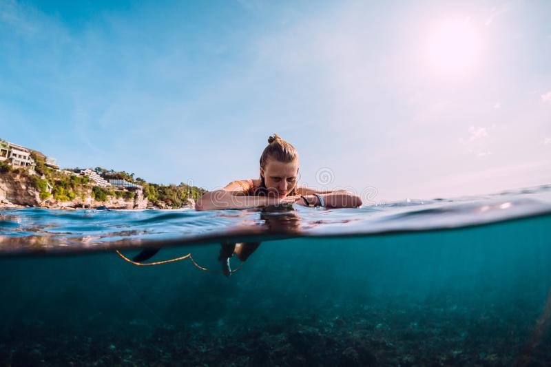 Attractive surfer woman relax in sea. Attractive surfer woman relax in ocean royalty free stock images