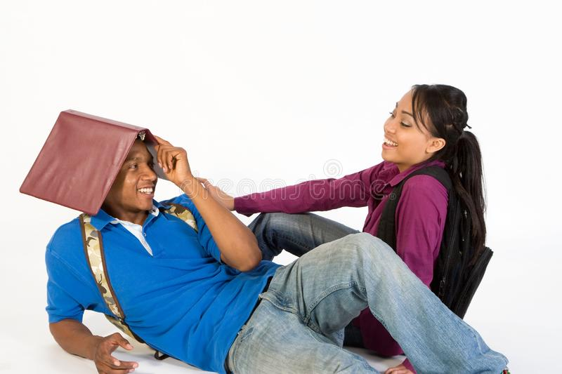 Attractive Teen Couple Flirting stock photography
