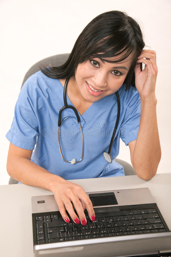 Attractive Thirties Asian Female Healthcare Worker Royalty Free Stock Photos