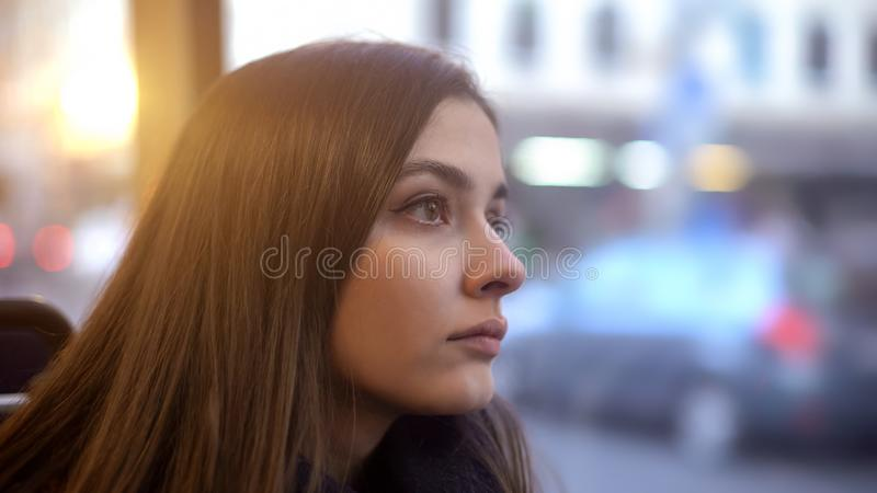 Attractive tired woman riding in bus, everyday routine, transportation concept stock photography