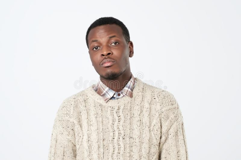 unhappy black young man over white background. Close up portrait royalty free stock image