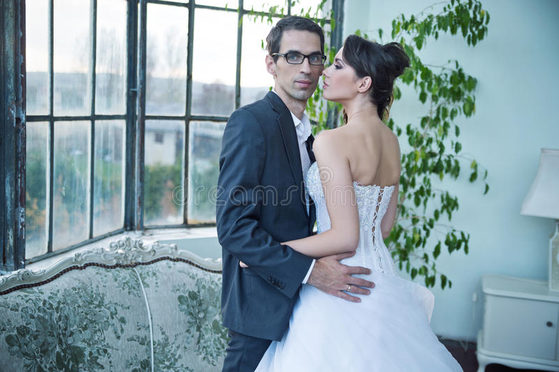 Attractive wedding couple after big party stock images