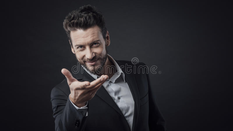 Attractive welcoming man royalty free stock photo