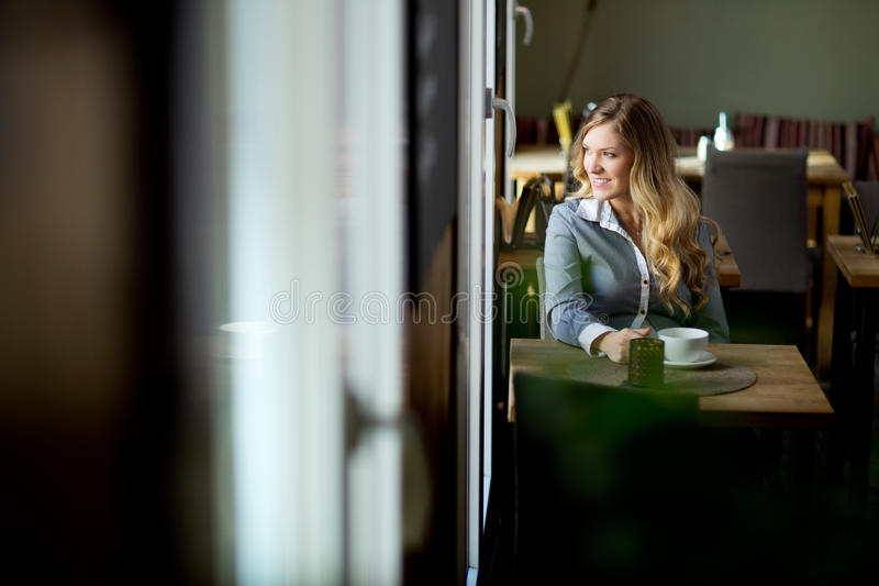 Attractive Woman Alone in Cafe stock images
