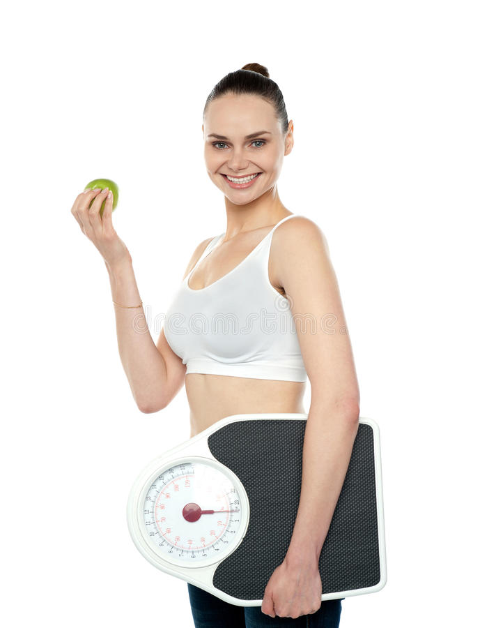 Download Attractive Woman With Apple And Weight Scale Stock Photo - Image: 26097590