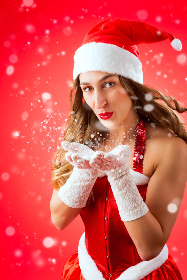 Download Attractive Woman As Santa Claus Blowing Snow Stock Image - Image: 27225205