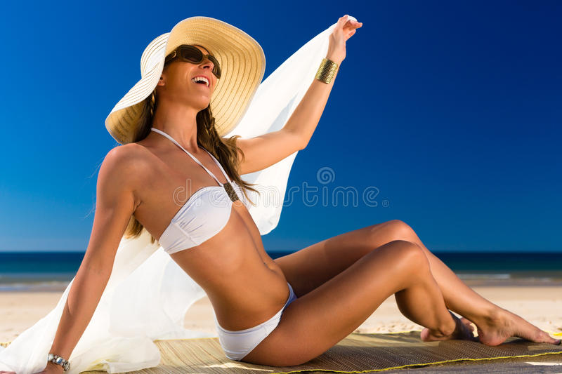 Download Attractive Woman In A Bikini Smiles At The Sun At The Beach Stock Photo - Image: 28156108