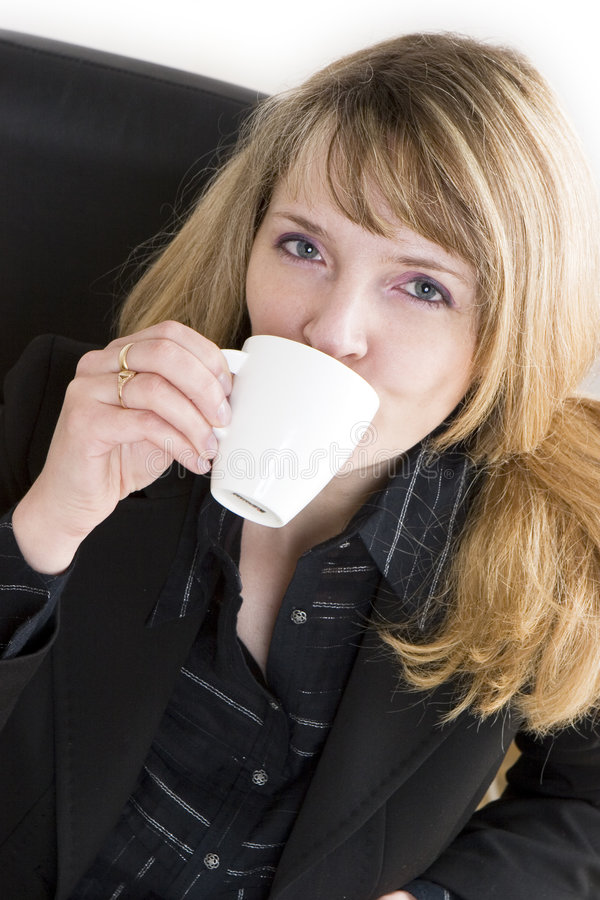 Download An Attractive Woman In A Black Suit Drinking A Cup Of Coffee Stock Photo - Image of caucasian, shirt: 2028040