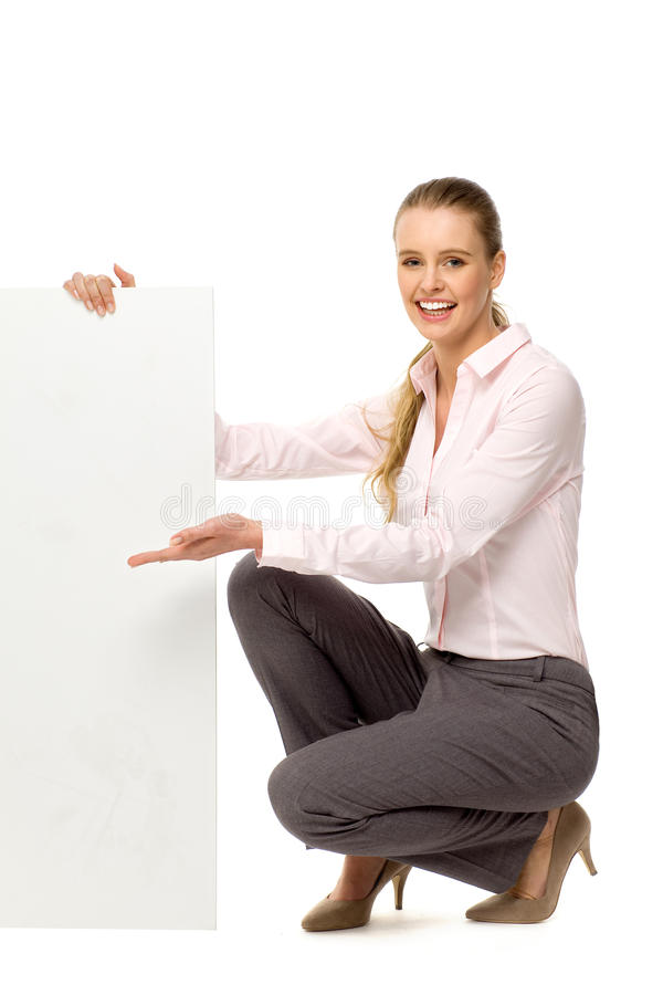 Attractive woman with blank poster stock photography
