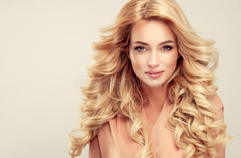 Attractive woman blonde with elegant hairstyle. stock image
