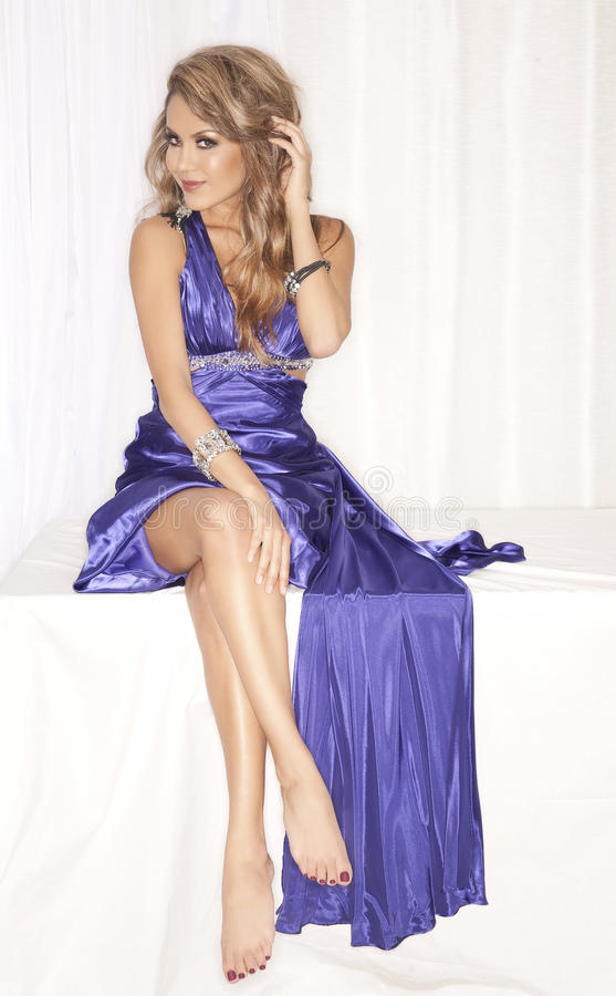 Attractive woman in blue dress stock image