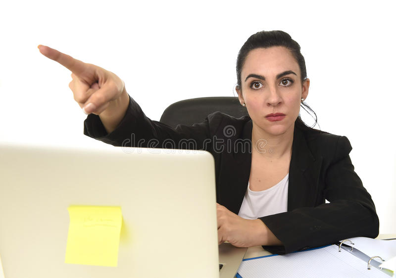 Attractive woman in business suit pointing with finger as if firing an employee stock photos