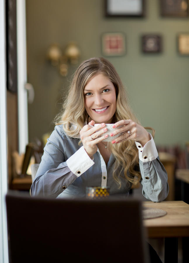 Attractive Woman in Cafe with Coffee royalty free stock images
