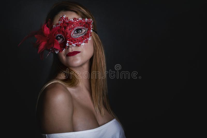 Attractive Woman With Carnival Mask. On black background stock image