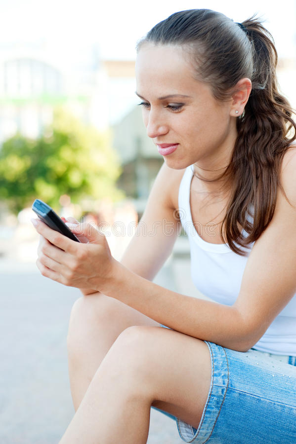 Attractive woman with cellphone stock image