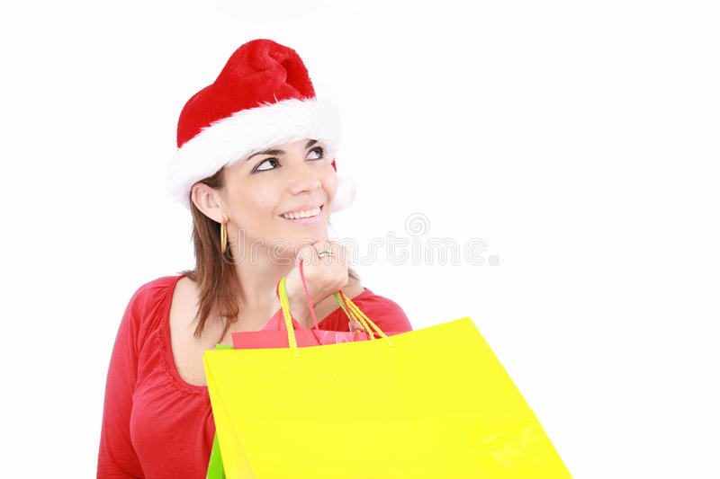 Attractive woman in Christmas cap royalty free stock photo