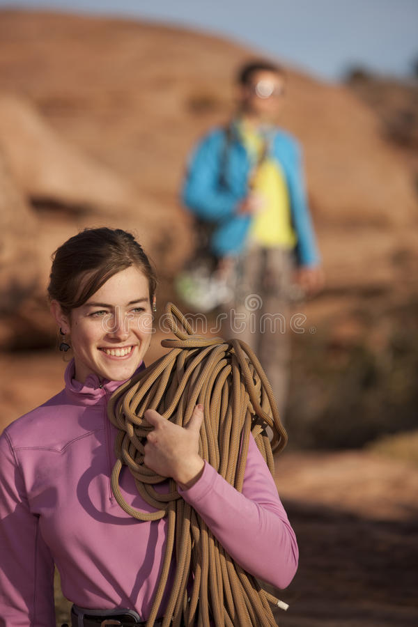 Attractive Woman With Climbing Gear Stock Photography