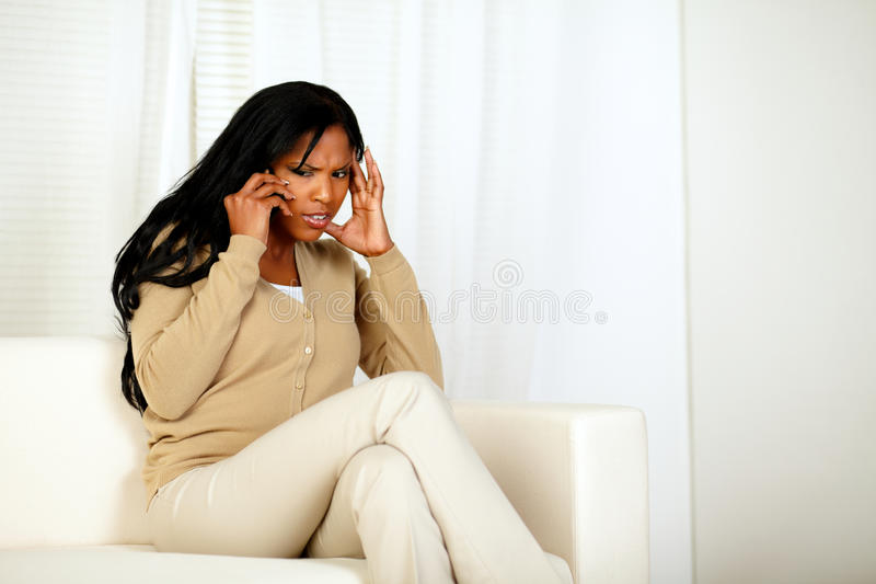 Attractive Woman Conversing On Cellphone Royalty Free Stock Images