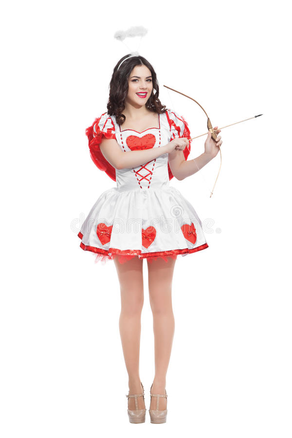 Attractive woman cupid with bow and arrow ready to. Valentines day cupid with bow and arrow ready to find love stock photo