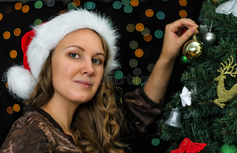 Download Attractive Woman Decorates Tree Royalty Free Stock Images - Image: 34655329