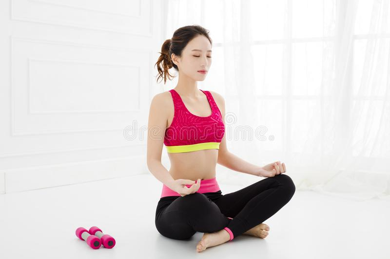 Attractive woman does yoga exercise at home stock photo