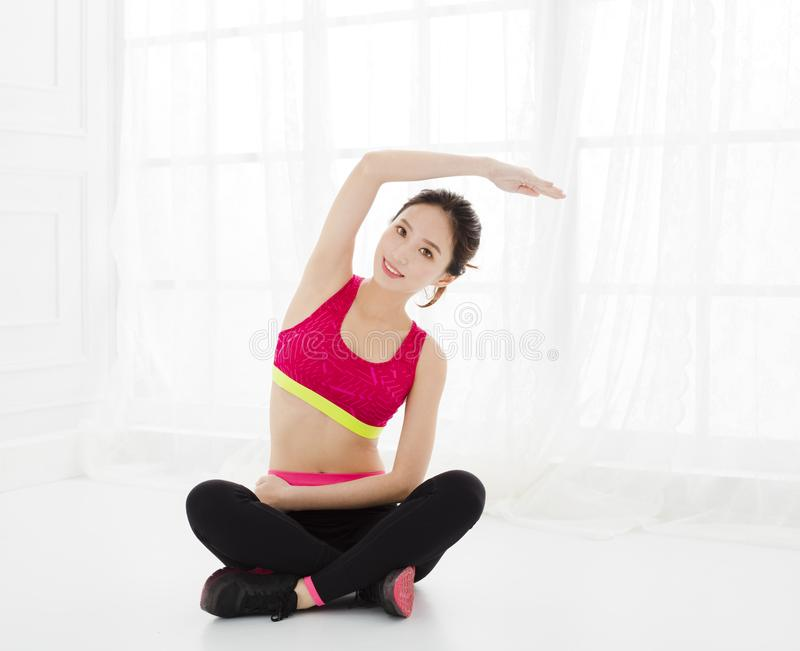 Attractive woman does yoga exercise at home royalty free stock photography