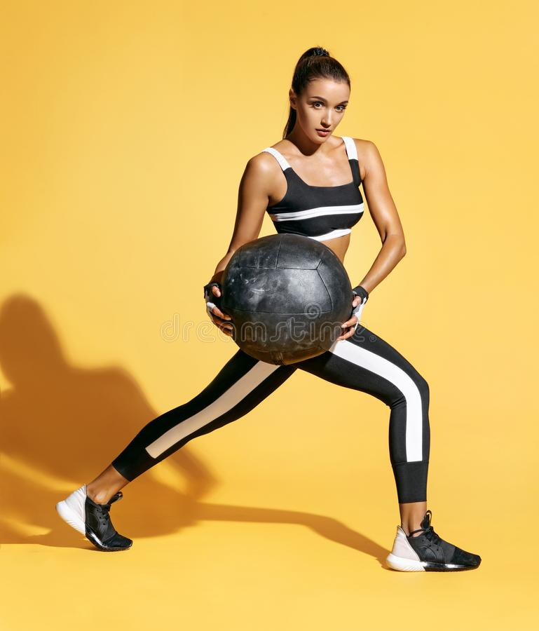 Attractive woman doing exercise with med ball. royalty free stock image