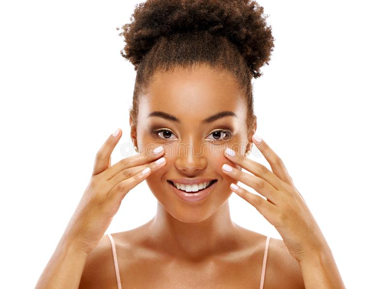 Attractive woman doing facial massage. Photo of african american woman royalty free stock photos