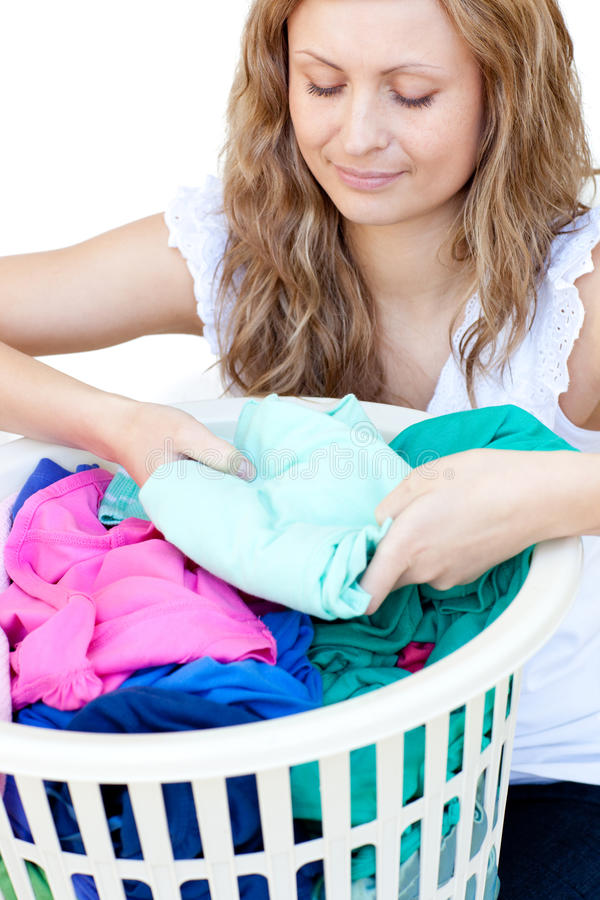 Attractive woman doing laundry royalty free stock photography