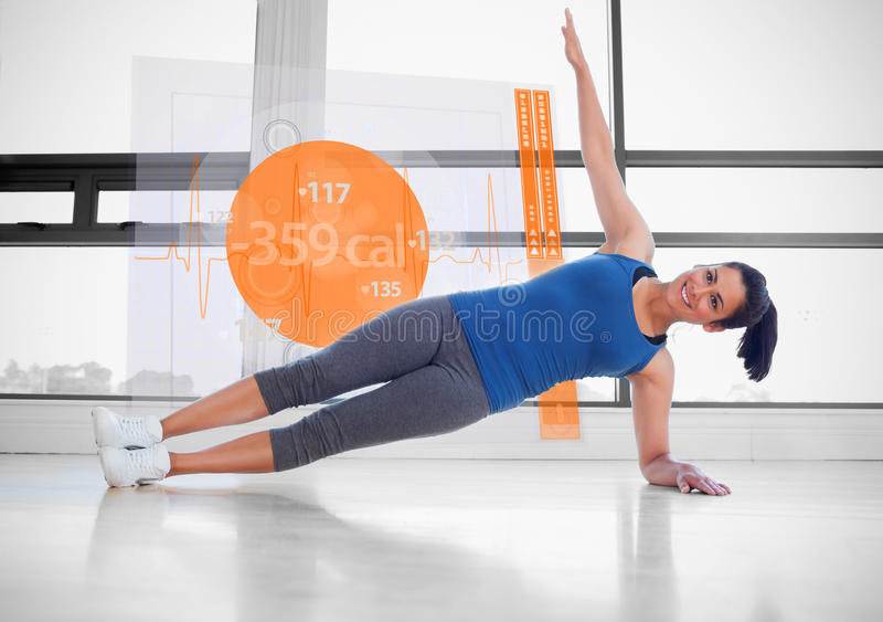 Attractive woman doing yoga with futuristic interface next to he. Attractive woman doing yoga with futuristic interface showing lost calories next to her royalty free illustration