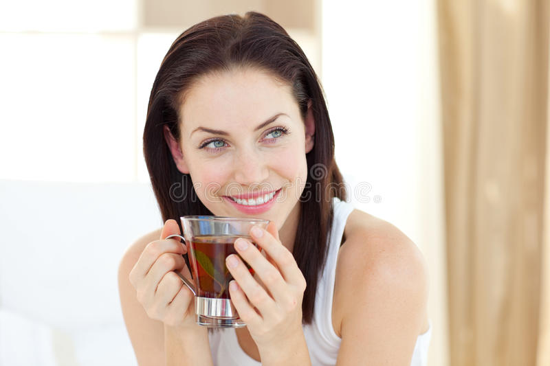 Attractive woman drinking tea stock photos